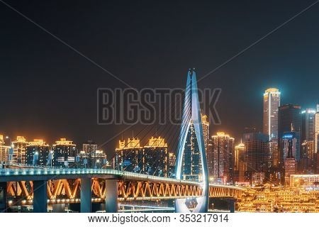 Chongqing, China - June 10, 2018 : Chongqing Skyline At Night With A Bridge And Hongyadong Cave