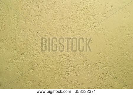 Dark Yellow Old Stucco Painted With Paint. Uneven And Not Uniform Vintage Putty Texture. Background.