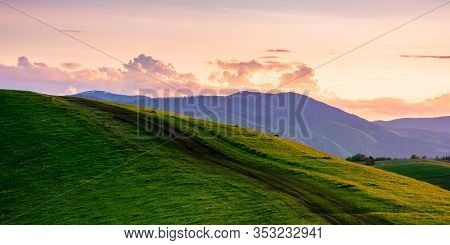 Rural Landscape In Mountains At Dusk. Amazing View Of Carpathian Countryside With Dirt Road Through
