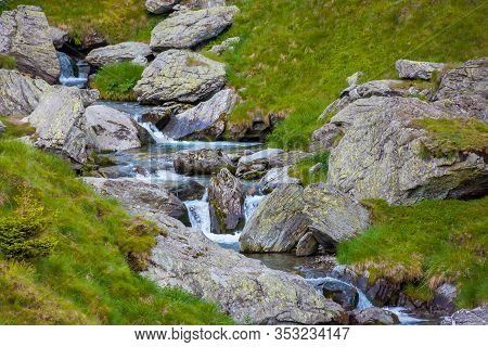 Balea Stream Among The Rocks. Beautiful Nature Scenery In Fagaras Moutains Romania