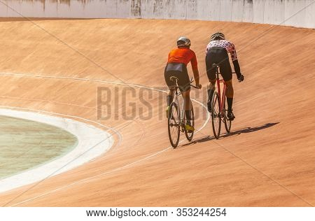 Back Side Two Bicyclists