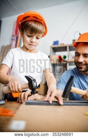 Smiling Parent And Kid Using Hand Tools Stock Photo