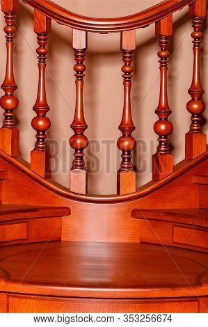 Fragment Beautiful Of A Wooden Staircase With Figured Carved Balusters And Railings And Tinted Mahog