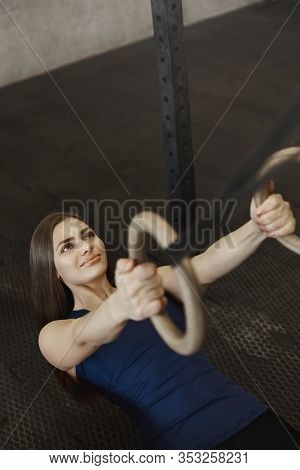 Vertical Upper-angle Shot Smiling, Strong And Energized, Motivated Woman Workout In Gym, Hanging On