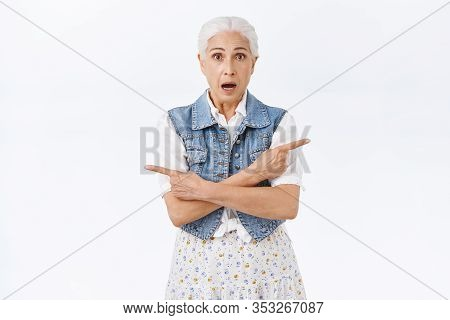 Indecisive Worried Old Woman With Grey Hair, Look Hesitant And Unsure Pointing Sideways, Left And Ri