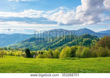 Gorgeous Rural Landscape In Mountains. Fields And Meadows On Hills Rolling In To The Distant Ridge.