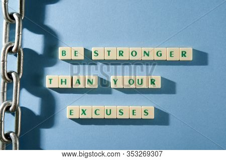 word be stronger than your excuses on the square blocks isolated on blue background