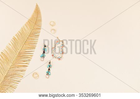 Woman Elegant Jewelry With Golden Leaf Over Beige Leather Background. Online  Jewelry Store, Gift Id