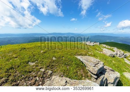 Rocks On The Alpine Meadow. Beautiful Summer Landscape Of Runa Mountain. Rural Valley In The Distanc