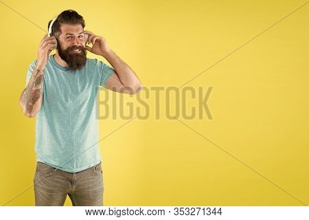 Dj, Let Music Play. Dj Man Yellow Background. Bearded Man Listen To Music In Dj Headphones. Hipster