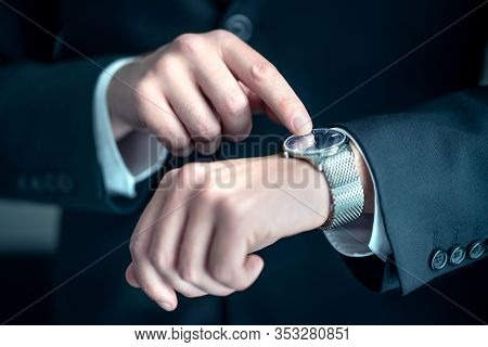 Watch Around The Wrist Of A Stylish Business Man. Busy Businessman Looking At The Time. Stress Or Hu