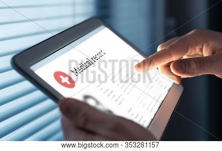 Medical Record In Electronic Form. Digital Emr With Patient Health Care Information. Doctor Using Ta