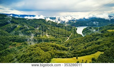 Clouds Of Fog After Summer Rain. Landscape With Lake And Mountain Woodland