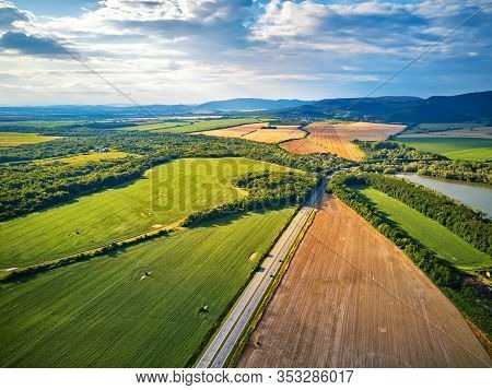 Summer Landscape With Fields, Meadows, Lake And Mountains. Aerial View