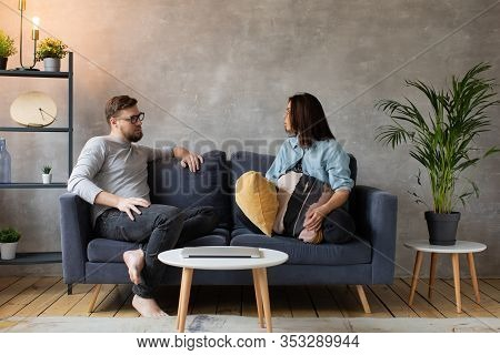 Young Couple Arguing On The Couch At Home. The Wife Shouts At Her Husband. Social Video. Aggression,