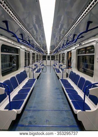 Subway Car Inside View. Interior Of A Passenger Train. Blue Subway Car Seats Perspective. Empty Subw