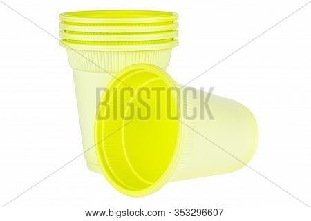 Lying One And Standing Four In Set Unused Green Disposable Cups Made Of Biodegradable Materials Isol