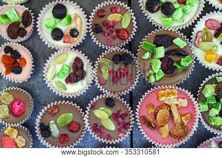 Cakes Top View. Stylish Cakes Decorated With Fruits, Dried Fruits And Candied Fruits. Sweet Backgrou