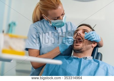 Beautiful Female Patient Having Dental Treatment At Dentist's Office.dentist And A Patient.people,me