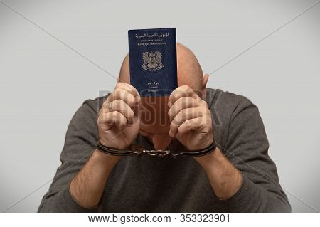 The Problem Of Illegal Immigration Of Refugees From Syria, A Syrian Immigrant In Handcuffs. Illegal