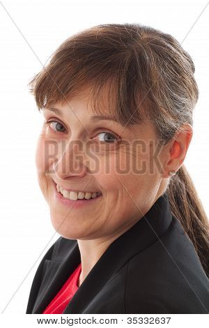Portrait Of Woman With Friendly Smile And Black Jacket.