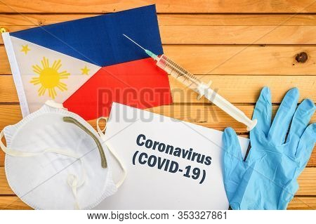 Coronavirus In Philippines,. Flag Of Philippines,, Vaccine, Face Mask For Virus, Glove And Paper She