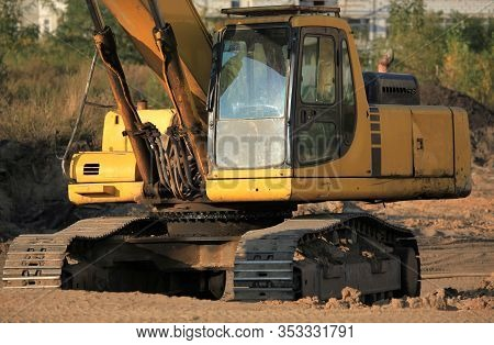 Excavator (digger) Close-up With A Huge Bucket At A Construction Site. Construction Machinery At The