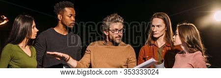 Panoramic Shot Of Multiethnic Actors And Actresses Rehearsing With Theater Director On Stage