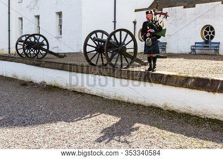 Bagpiper At Blair Castle