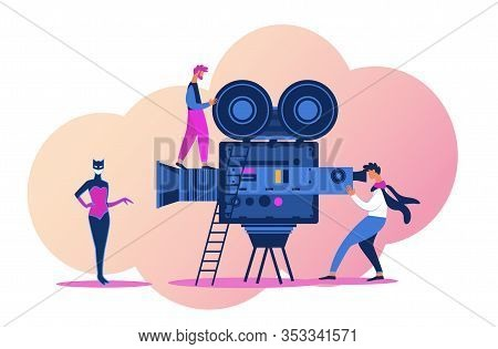 Video Operator Using Professional Equipment For Recording Movie. Famous Actress In Superhero Costume