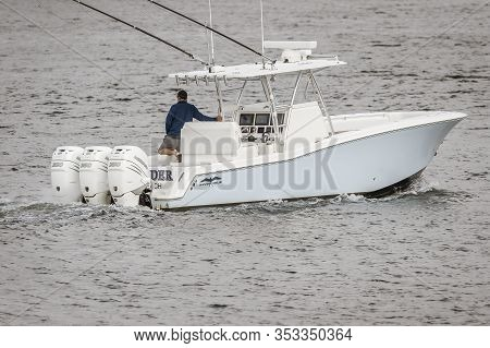 New Bedford, Massachusetts, Usa  - August 9, 2019: Center Console Boat Featuring Three Large Outboar