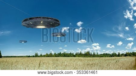 Ufo, An Alien Plate Hovering Over The Field, Hovering Motionless In The Air. Unidentified Flying Obj