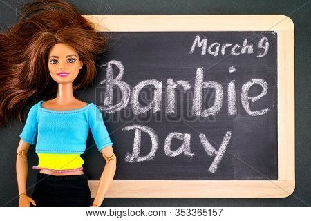Tambov, Russian Federation - February 24, 2020 Brown Hair Barbie Doll And Blackboard With Words Barb