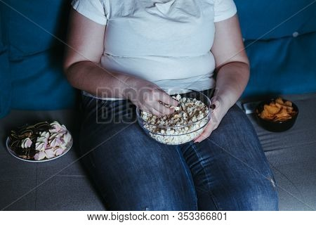 Nerve Food, Addiction, Eating Disorders, Bulimia. Overweight Woman Sit On The Coach With Big Amount