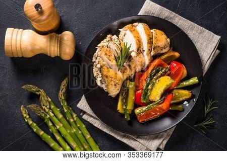 Baked Chicken Breast With Vegetables In Black Plate. Healthy Food, Keto Diet Meal. Top View At Dark