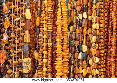 Beautiful amber jewellery for sale in Gdansk, Poland. Amber jewellery close up background