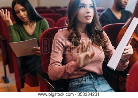 Multiethnic Actor And Actresses Reading Scripts In Theatre
