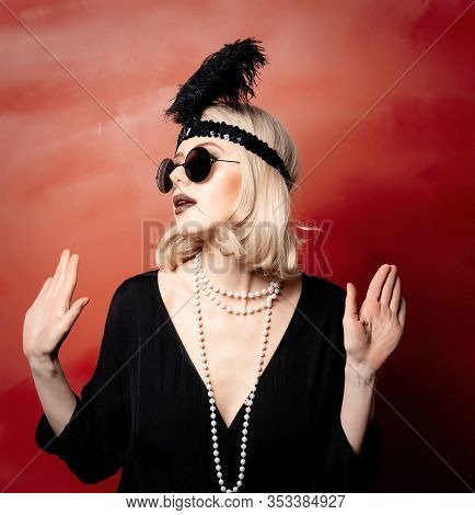Beautiful Blonde Woman In Twenties Years Clothes And Sunglasses