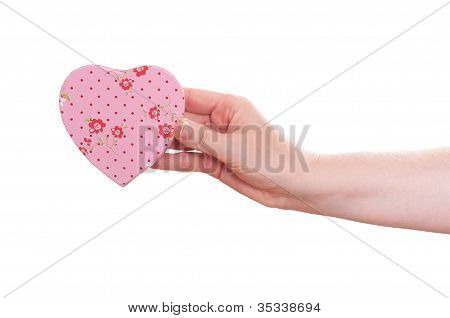 Female Hand Is Holding A Pink Heart