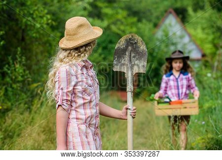 Girls With Gardening Tools. Summer At Countryside. Sisters Helping At Backyard. Child Friendly Garde