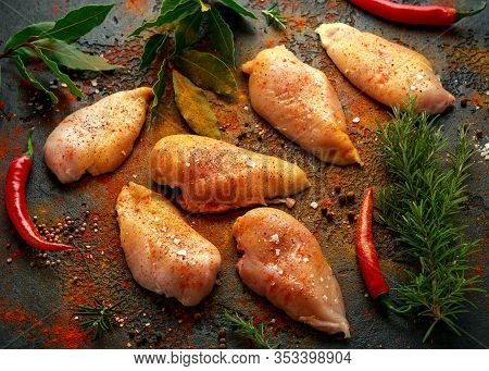 Raw Ready To Cook Free Range Chicken Breast Fillets Seasoned With Paprika, Cracked Pepper And Sea Sa