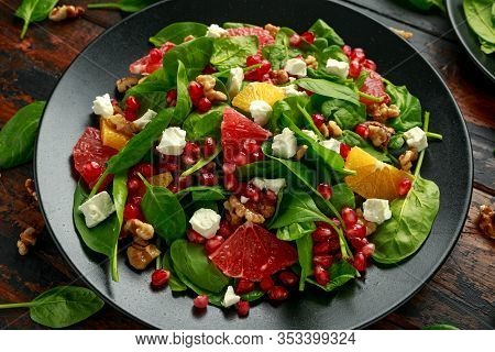 Orange Grapefruit Salad With Spinach, Walnuts, Pomegranate Seeds And Feta Cheese. Healthy Food
