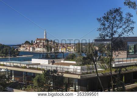 Rovinj, Croatia - Februar 28, 2020 - Unidentified Falcon Whisperer Sit On Terrace Of Modern And Luxu