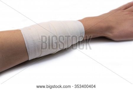 Wide Bandage With A Sterile Gauze On An Arm Of A Young Boy And The White Background