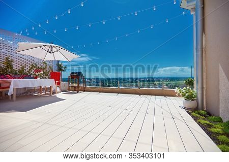 Furnished Patio Zone, Rooftop Terrace At Warm Summer Day