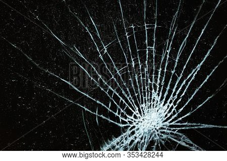 Shattered Glass Window Against A Black Background