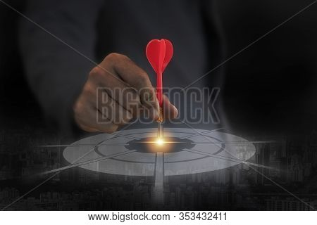 Businessman Holding Red Dart Arrow And Point To Target.achieve Business Concept Target.
