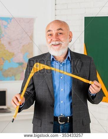 Let Me Explain. Customized Learning Experiences. Senior Intelligent Man Teacher At Chalkboard. Teach