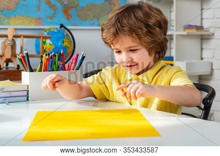 Little Children At School Lesson. Portrait Of Pupil In Classroom. Home School For Pupil. Home School