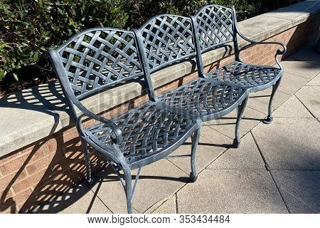 Three 3 Joined Beautiful Vintage Old Green Metal Garden Chairs Bench In The Morning Sunlight With Sh